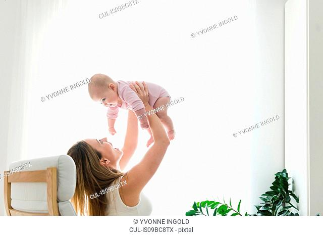 Mother lifting baby up