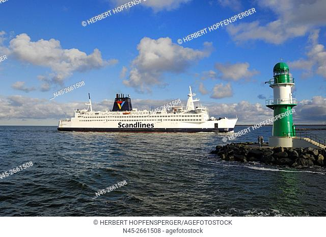 Scandline Ferry, green Lighthouse in front of the Baltic Sea, West Mole, Harbor Entrance, Warnemuende, Germany
