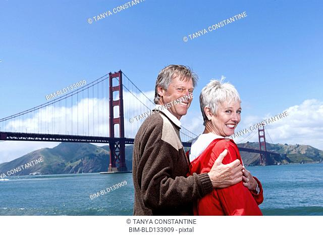 Senior Caucasian couple smiling by Golden Gate Bridge, San Francisco, California, United States