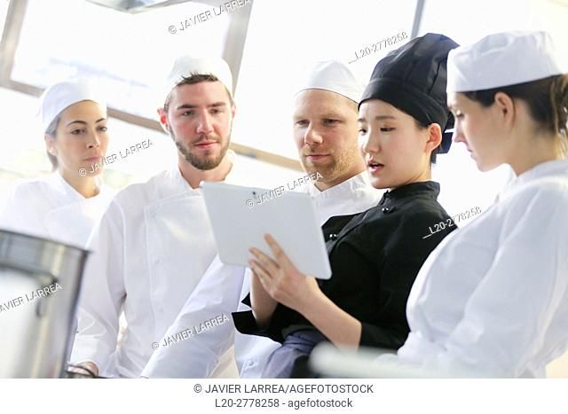 Chef with tablet, Cooks in cooking school, Cuisine School, Donostia, San Sebastian, Gipuzkoa, Basque Country, Spain, Europe