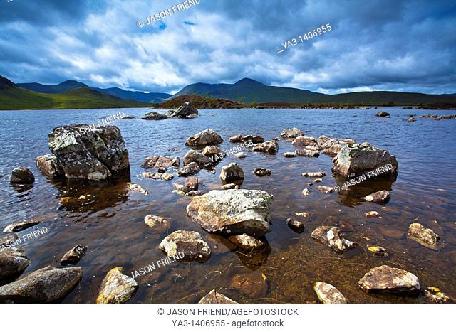 Scotland, Scottish Highlands, Rannoch Moor  Lochan an Stainge located on Rannoch Moor with the dominating peak of the Black Mount and surrounding mountains in...