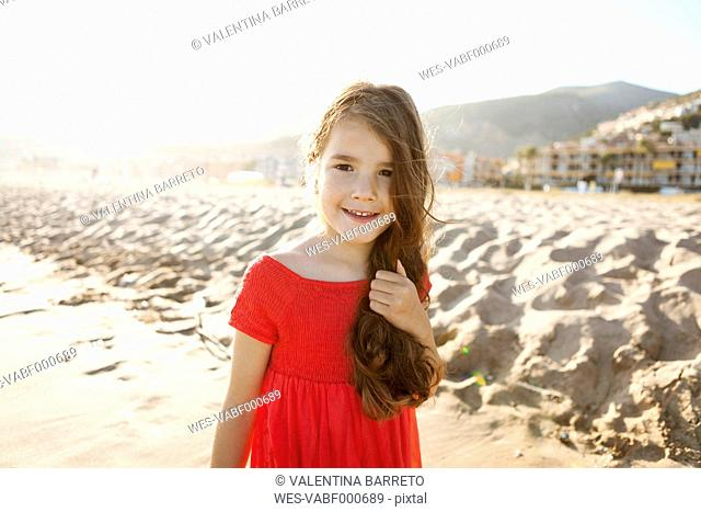 Portrait of smiling little girl on the beach