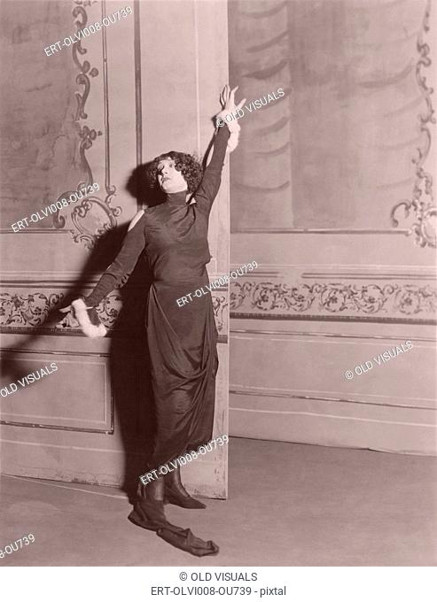 Woman standing in dramatic pose