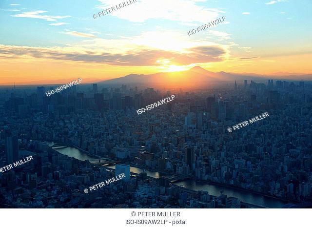 Elevated cityscape view with sunset over Mount Fuji, Tokyo, Japan