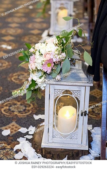 Candles used for decor at this candlelight wedding ceremony in an old traditional church