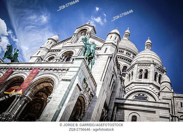 Basilica Sacre Coeur with monument, Paris