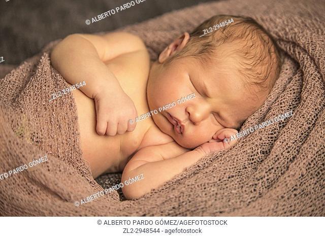 One week old baby sleeping