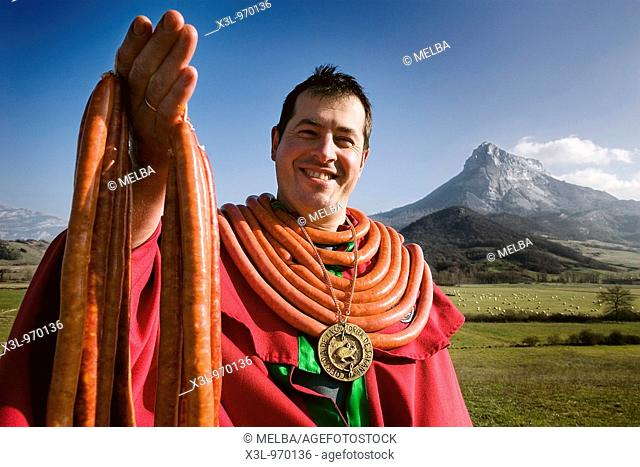 Man holding chistorra, a type of sausage made in Navarra  Spain