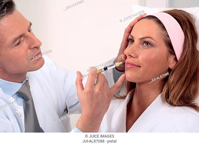 Woman receiving anti-aging injection in face