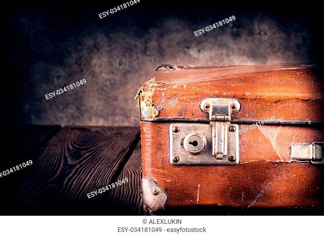Old crumpled bag on a wooden background