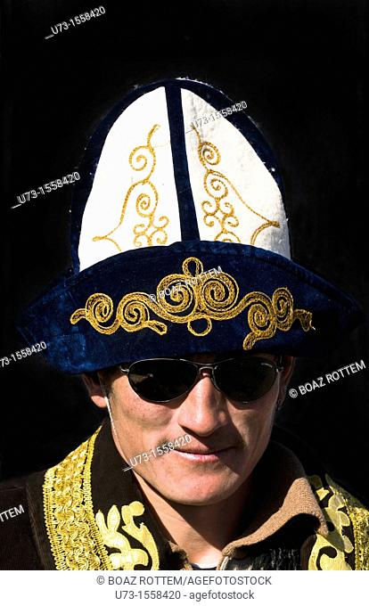 A Kazakh man wearing a traditional Kazakh hat