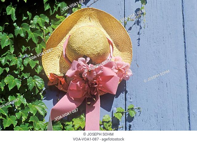 Decorated straw hat nailed onto a door