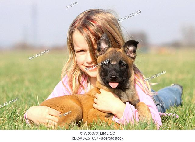 Girl with Belgian Malinois puppy