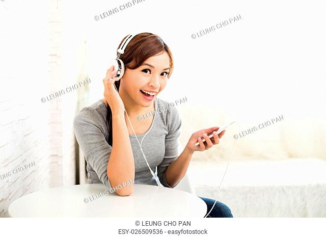 Woman enjoy listen to music by headphone