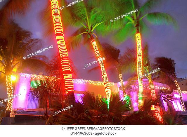 Florida, Miami Beach, Art Deco District, Ocean Drive, hotels, restaurant, Mangos Tropical Cafe, night, nightlife, palm trees, Christmas lighting, decorations
