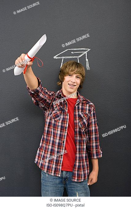 A boy holding a scroll and a chalk mortar board