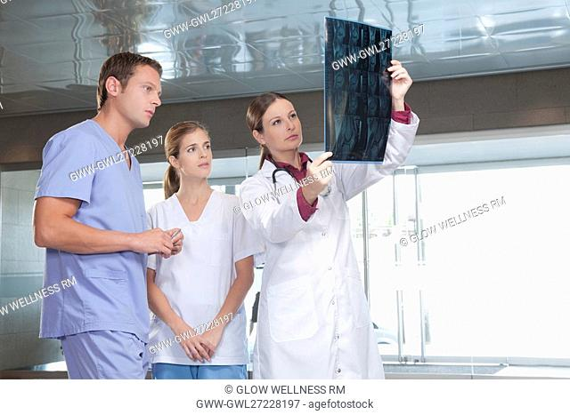 Doctors examining an X-Ray report