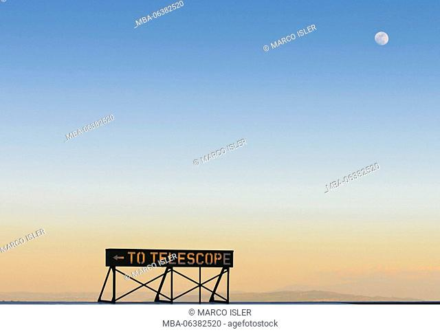 Moon over the Griffith Observatory sign, USA, California, Los Angeles
