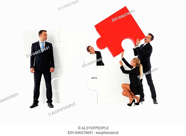 Business teamwork with big puzzle