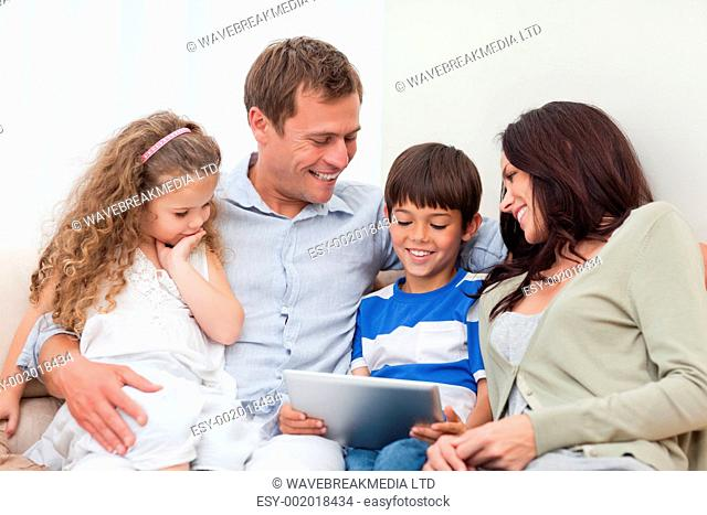 Young family using tablet together