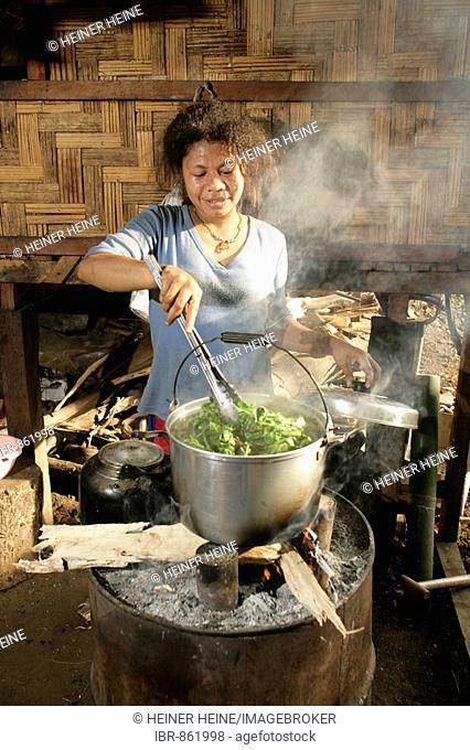 Woman preparing a meal, Biliau, Papua New Guinea, Melanesia