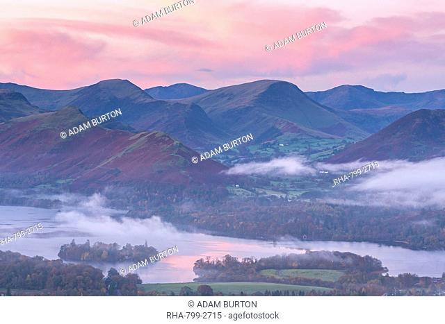 Misty autumn sunrise over Derwent Water and the Newlands Valley, Lake District National Park, Cumbria, England, United Kingdom, Europe
