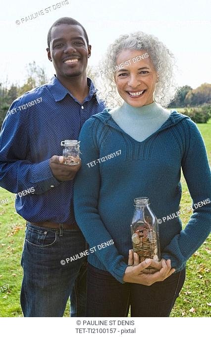 Couple holding jars