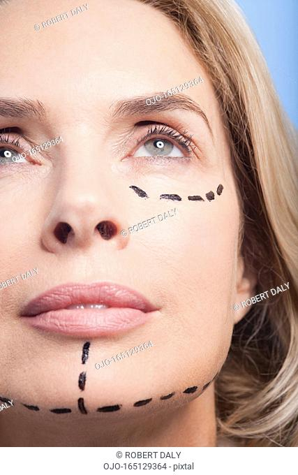 Close up portrait of woman with dotted lines on face