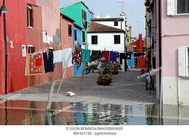 Flooded street in Burano, Burano Island, Venice, Veneto, Italy, Europe