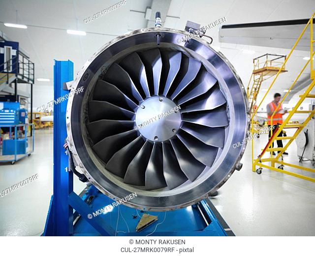 Jet engine in aircraft hangar