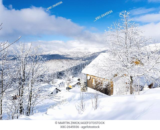 Village Waldhaeuser in the National Park Bavarian Forest (Bayerischer Wald) in the deep of winter. View towards mount Rachel and mount Falkenstein