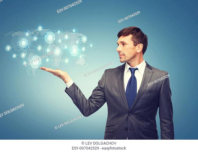 business and office concept - attractive buisnessman or teacher showing world map hologram on the palm