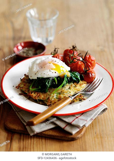 Rösti with fried egg, spinach and fried vine tomatoes