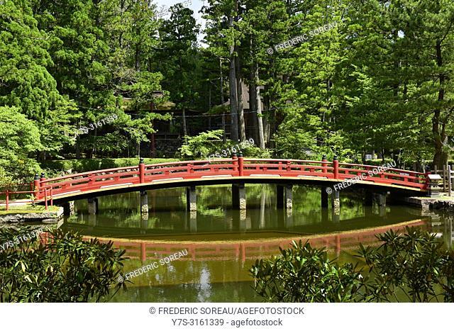 A traditional red Japanese bridge at Okunoin temple on Koyasan, Japan, Asia