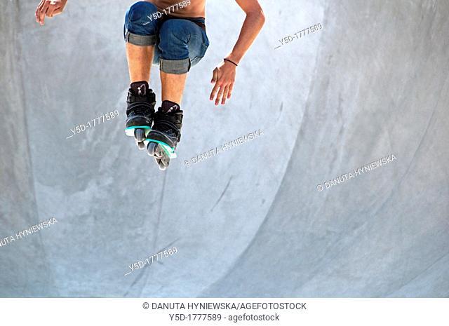 Roller skater jumping in the air, Plainpalais skatepark, Geneva, Switzerland