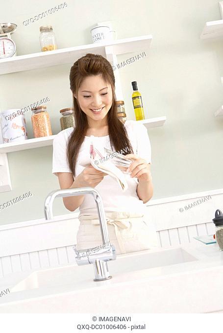 Woman wiping glass