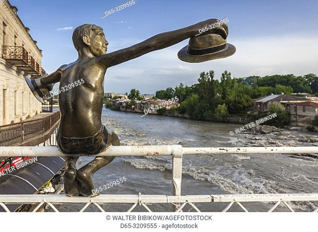 Georgia, Kutaisi, statue of boy with hat on the Rioni River footbridge, NR