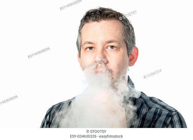 picture of a man exhaling smoke