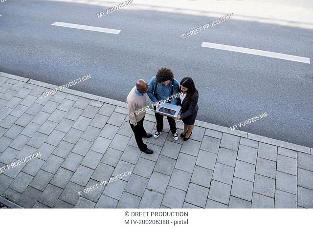 Meeting men woman laptop computer from above