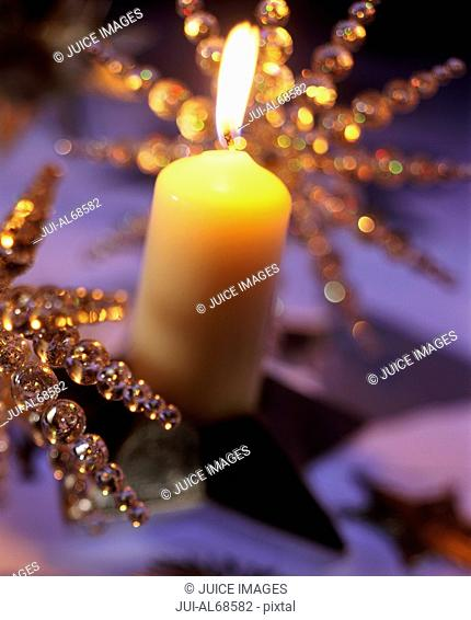 Detail view of a candles and a Christmas ornament