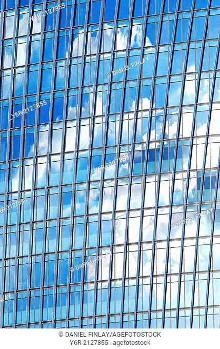 Clouds reflected in a modern office building in Southwark, close to the Shard, in the heart of London, England