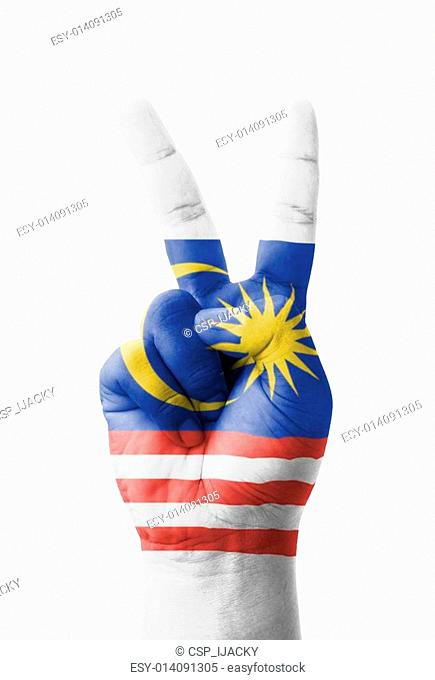 Hand making the V sign, Malaysia flag painted