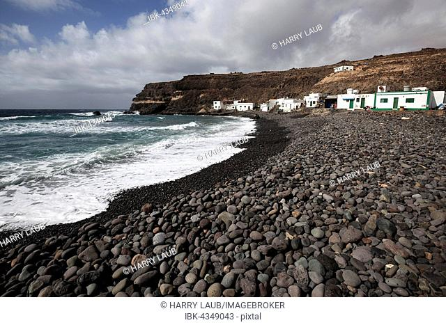 Lava, lava rocks on the beach, Los Molinos fishing village by the sea, Fuerteventura, Canary Islands, Spain
