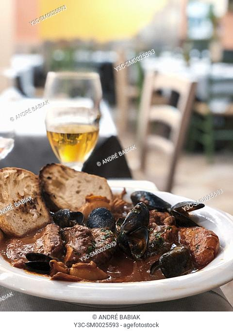 Cacciucco alla Livornese, traditional Livorno seafood dish with mussels, octopus, fish, squid, shrimp, Italian food