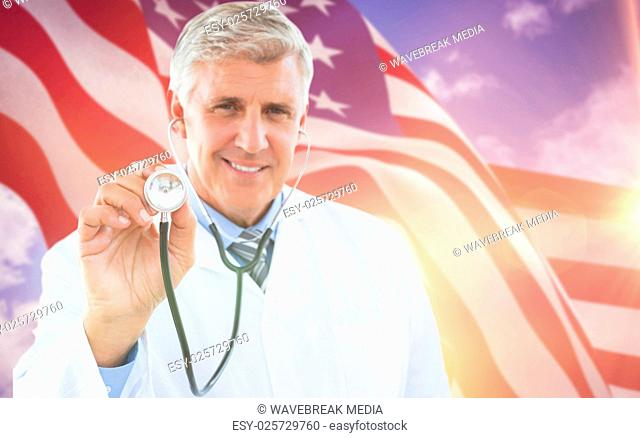 Composite image of happy doctor smiling at camera and showing his stethoscope
