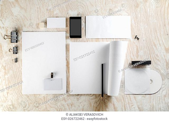 Photo of blank stationery set on light wooden background. Template for design presentations and portfolios