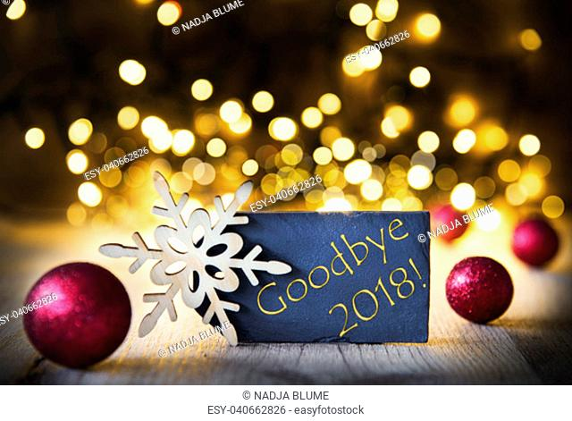 Plate With Golden English Text Goodbye 2018. Bright Glowing Lights In The Background. Christmas Ornament Like Red Balls And Snowflake