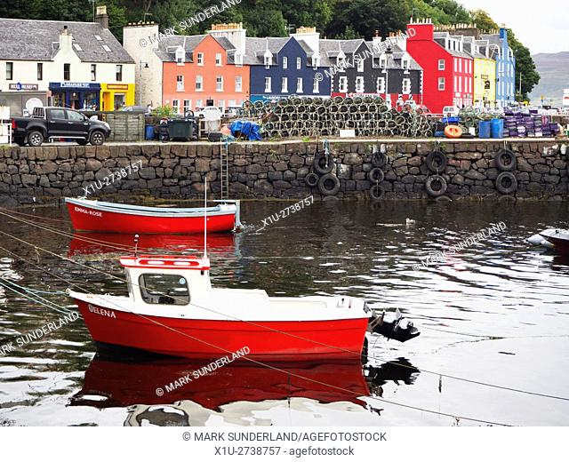 Red Boats in the Harbour below the Colourful Houses on the Waterfront at Tobermory Mull Argyll and Bute Scotland