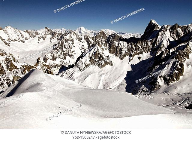 Two skiers seen from Aiguille du Midi, close to Mt Blanc, French Alps, France