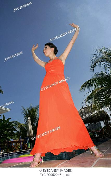 Woman posing outdoors wearing a fashionable sundress